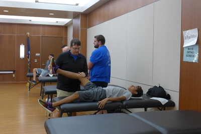 sports medicine physical day - doctors assisting patients